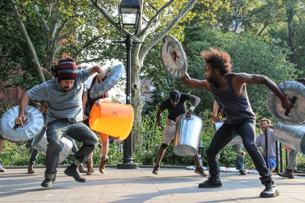 STOMP performs at the rally, showing their support for the cause. Photo by Tequila Minsky.